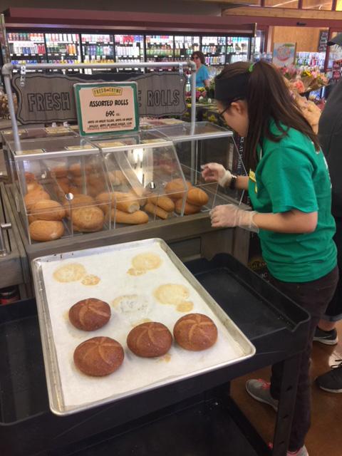 Betsy loading bread from tray